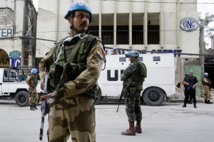 Indian FPU Officer in conjunction with Brazilian UN peacekeepers secures the perimeter of a bank downtown. Port au Prince Haiti was rocked by a massive earthquake, Tuesday January 12, devastating the city and leaving thousands dead. Photo Marco Dormino