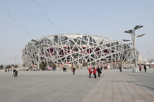 Beijing, China - April 2nd, 2013: Tourists and souvenirs sellers in front of National Stadium in Chaoyang District, commonly known as Bird's Nest