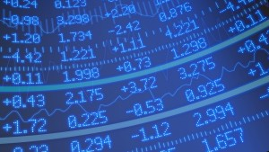 Stock market ticker background in blue with various numbers and graphs