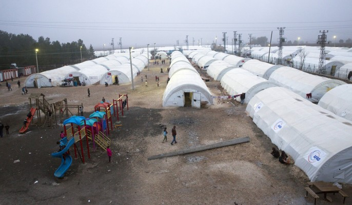 Suruc, Turkey - December 02, 2014: Unnamed syrian (kurdish) people in refugee camp in Suruc. These people are refugees from Kobane and escaped because of Islamic state attack.